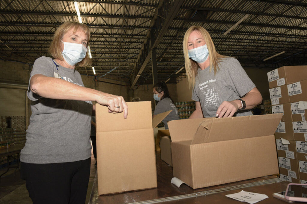 Cindy Silva and Susan Coyne of Cleveland Clinic Martin Health pack  boxes
