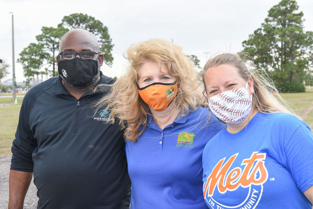 Will Armstead, TC Food Bank President and CEO Judith Cruz, and Kasey Blair of the Mets Organization